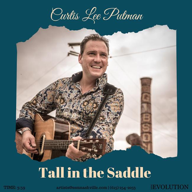 man wearing brown paisley shirt playing guitar